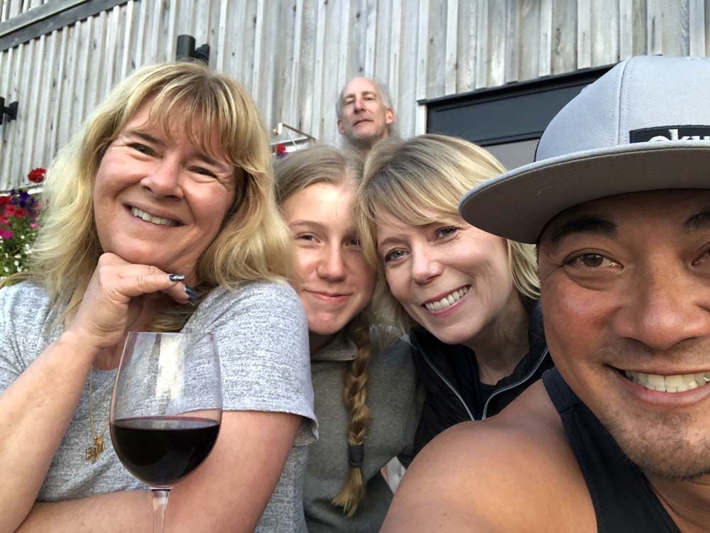 guests at salmon fishing lodge enjoying friends and wine