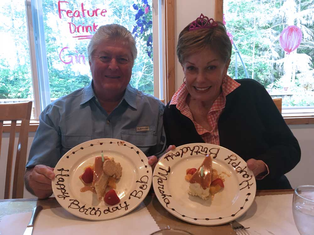 Couple enjoys dessert at lodge