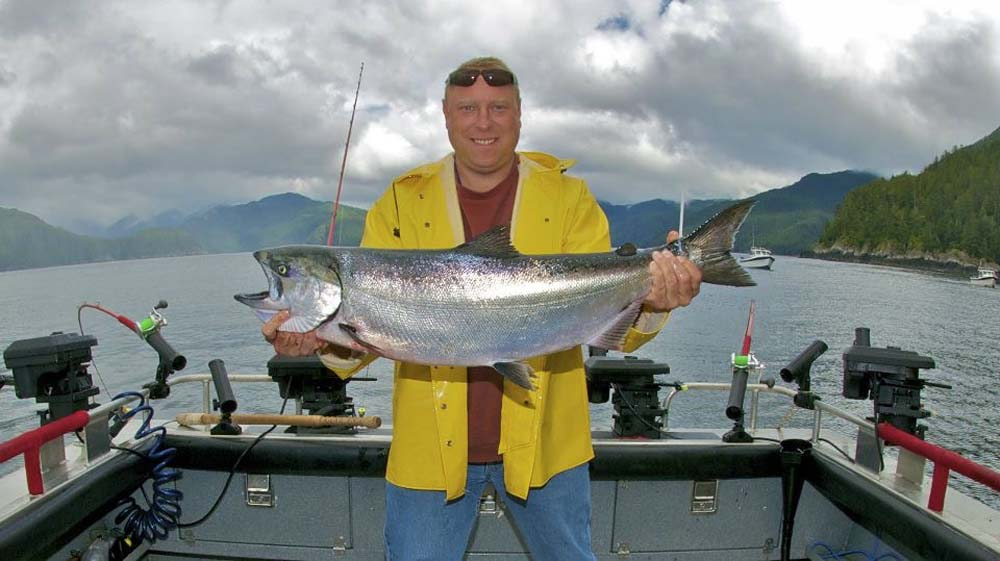 fisherman with caught salmon