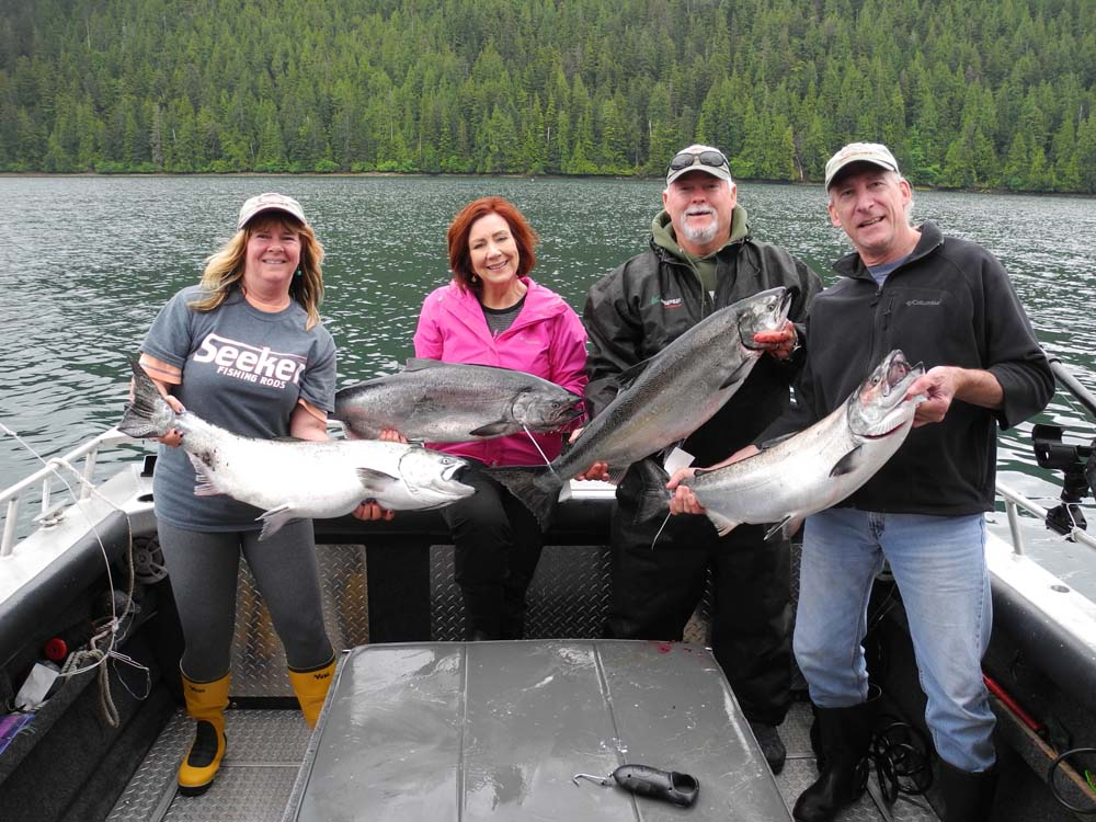 four fishermen and fisherwomen with catch of Chinook Salmon