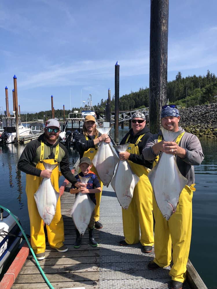 Family with their catch of Halibut